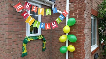 A banner upoutside Foz Foster's housewishing David Pike a happy retirement.