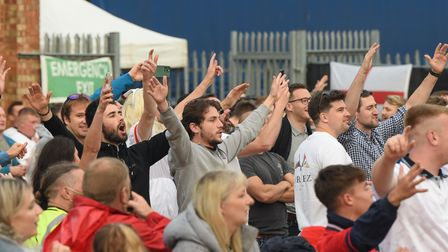 Fans singing the national anthem for the England v Ukraine match at The Arena in Sprowston. Picture:
