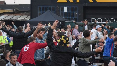 Fans at The Arena in Sprowston celebrate another England goal against Ukraine in the Euros. Picture: