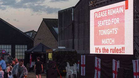 A 'Please remain seated for tonights' match' sign coming on the screen at The Arena in Sprowston for