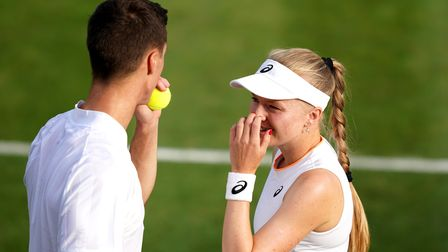 Joe Salisbury and Harriet Dart discuss tactics during their mixed doubles first round match against
