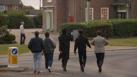 The five main characters from The World's End as youths walk towards The First Post pub.