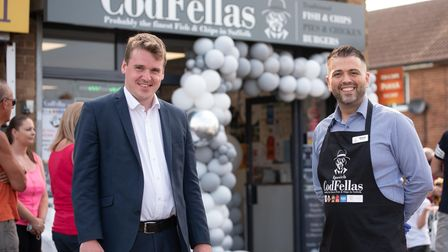 Ozzie Bozdag, owner of Codfellas fish and chip shop chatting to Tom Hunt MP. Picture: Sraah Lucy Br