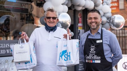 Gordon Marsh with his fish and chips with Ozzie Bozdag, owner of Codfellas. Picture: Sraah Lucy