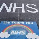 Sign painted on approach road to Hinchingbrooke Hospital during covid pandemic.