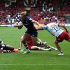 Bristol Bears' Max Malins evades a tackle from Harlequins' Tyrone Green to score a try in extra time