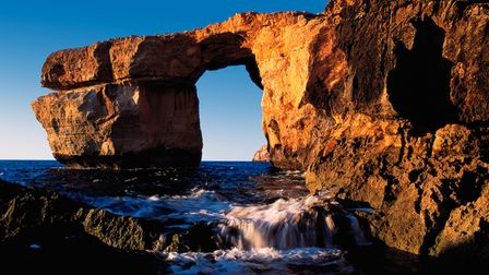 The drama of the limestone arch on Gozo, theWied il-Mielah, is best seen at sunset