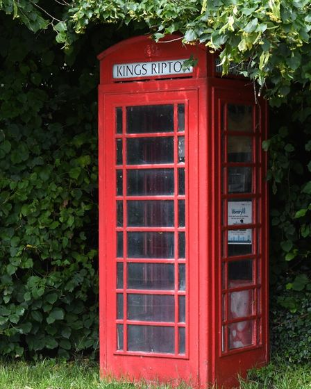 Kings Ripton still has its traditional red telephone box.