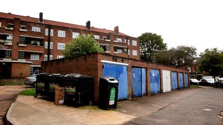 Garages facing onto Barrington Road where three terraced houses would be built