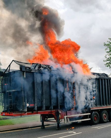 Plumes of smoke bellow from the trailer of a lorry which burst into flames in Hitchin earlier today (July 5)