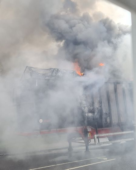The lorry trailer in Hitchin is still smouldering three hours after fire crews were first alerted to the blaze