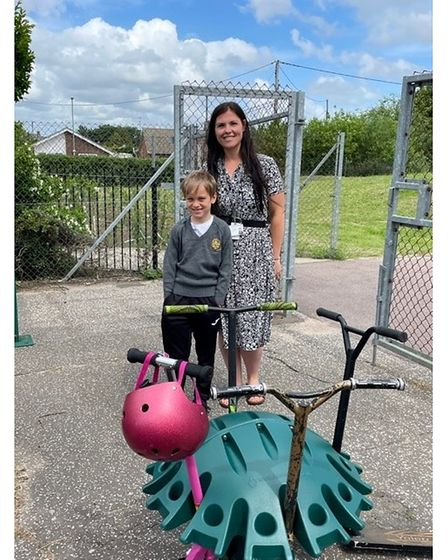 Assistant headteacher Gemma Hurren and Oliver Grant, withthe pod that was won for the school.
