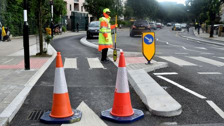 Traffic cones are used to temporarily block the cycle lane outside Drayton Park Primary School durin
