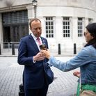 Matt Hancock looks at the phone of his aide Gina Coladangelo as they leave the BBC in central London in June