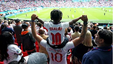 Boy on dad's shoulders at England football match