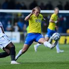 Jake Andrews of Torquay United blocks the shot from Tomi Adeloye of Barnet during the National Leag