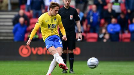 Armani Little of Torquay United sticks the ball into the net during the National League Play-off Fin