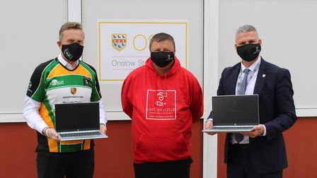 Hatfield Rugby Club with Love Hatfield donating laptops to Onslow St Audrey's School.