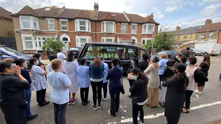 staff at Woodlands Nursing Home line the street to pay tribute to their late colleague Usha Patel