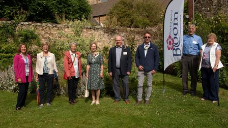 South West In Bloom judge Lynette Talbot with members of Portishead In Bloom at theMillennium Garden in Portishead.