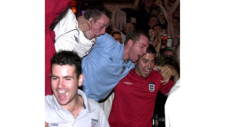 Fans celebrating England's World Cup victory over Denmark at Brannigans in Ipswich in 2002