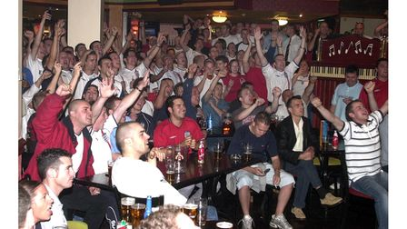 England fans celebrating in Brannigans as England beat Denmark in the World Cup in 2002