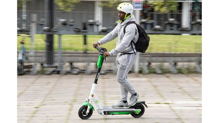 EDITORIAL USE ONLY Kevin Kallon rides an e-scooter as Lime launches the UK's first, full-scale e-sco