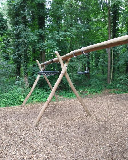 One of the swings at Holt Country Park wrapped around the frame.