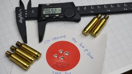 A five-round group at 200 metres from primary test loads before true customisation began