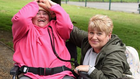 Bonnie Large who has Angelman Syndrome, and is struggling with pain, possibly from her teeth, pictur