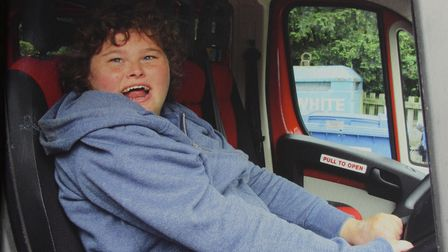 Bonnie Large who has Angelman Syndrome, and is struggling with pain, possibly from her teeth. Pictur