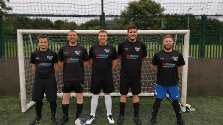 Members of the Match of the Dad football league wearing the new shirts sponsored byNorfolk and Waveney Wellbeing Service.
