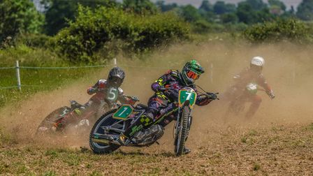A muddy field - Gosbeck, Suffolk. At the centre, motorbike number 7 at a very steep angle, as if turning.