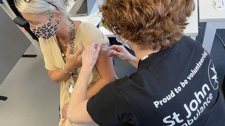 St John Ambulance volunteer Dawn Taylor administers COVID 19 injections at the Lowestoft Vaccination Centre.