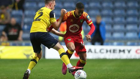 Sam Long of Oxford United and Rob Nizet of Norwich City in action during the EFL Trophy match at the