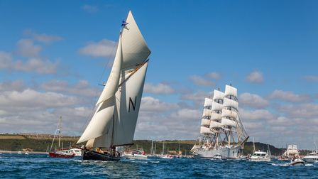 Tall Ships and small craft head out to sea
