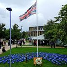 A wreath was laid next to 511 flags – one for every person who has died with COVID-19 at the East and North Herts NHS Trust