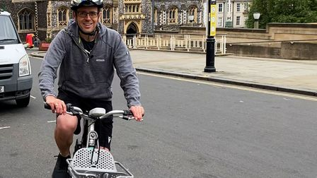 Neil Perry, on a bicycle arriving at City Hall ahead of the competition