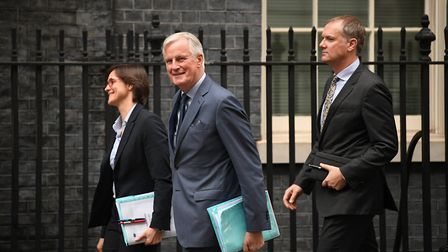 EU Chief Brexit Negotiator, Michel Barnier (centre) in Downing Street ahead of a meeting with Boris