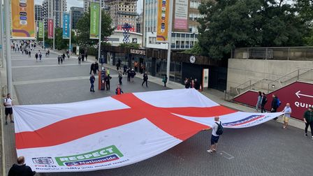 England fans waving a flag outside Wembley Stadium prior to the semi-final clash against Denmark