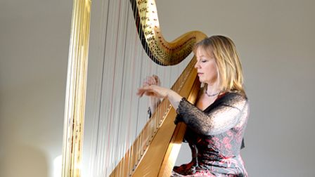 Harpist Ruth Holden will appear in St Ives on July 30.