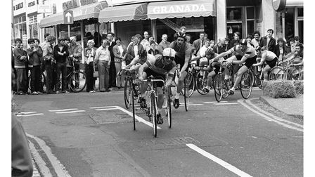 Tricycles making it round the corner with crowds cheering themduring the Ipswich cycle race around town in 1981