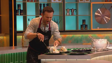 Harry Judd making a mess in the kitchen during episode one ofCooking With The Starson ITV.