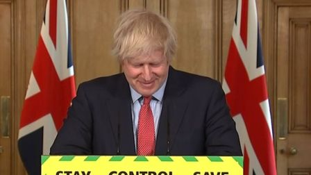 Prime Minister Boris Johnson smiles during a media briefing in Downing Street, London. Photograph: P