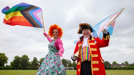 Titania Trust with Norwich Pride town crier Mike Wabe at the Norwich Pride Schools Week parade at Sewell Park Academy.