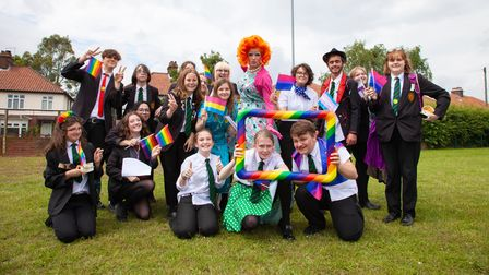 Students and Titania Trust at the Norwich Pride Schools Week parade at Sewell Park Academy in Norwich.