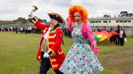 Norwich Pride town crier Mike Wabe with Titania Trust at theSewell Park AcademyNorwich Pride Schools Week parade.