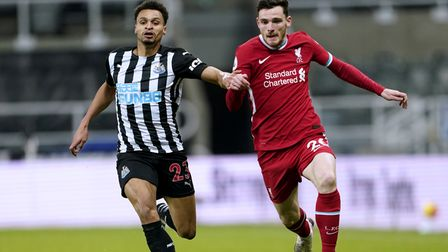 Newcastle United's Jacob Murphy (left) and Liverpool's Andrew Robertson battle for the ball during t