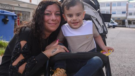 Sam Moore, pictured with her son Jayden, who got a penalty notice after parking in an adult and chil