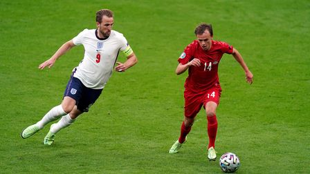England's Harry Kane (left) and Denmark's Mikkel Damsgaard battle for the ball during the UEFA Euro